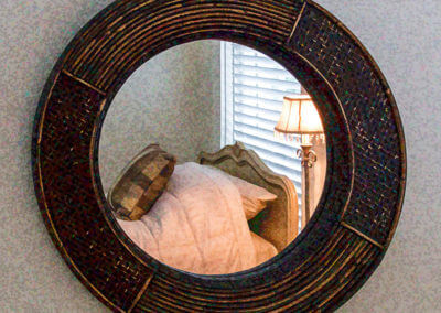 round-mirror-and-twin-bed-painting